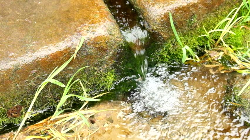 Hands washing in fresh crystal clear water from stony rural fountain. Natural drinking water from mountain stream.  - HD stock footage clip