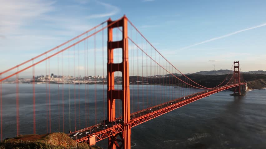Time-lapse and tilt-shift miniature effect of the famous Golden Gate Bridge, focus on road and traffic, San Francisco, California, USA - HD stock footage clip