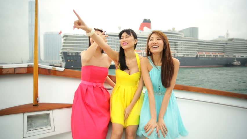 Wealth happy young American Asian Chinese girlfriends outdoors sailing yacht outdoors harbour cityscape sightseeing travel destination   Shutterstock HD Video #7849705