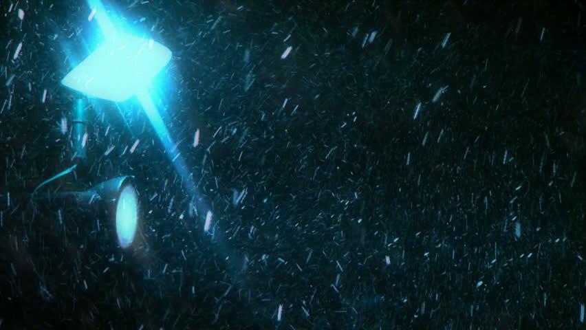 Snowfall blue. Snowfall is illuminated lantern blue light. Against the dark night. - HD stock video clip
