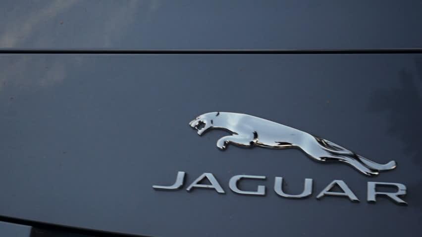 LONDON, UNITED KINGDOM - NOVEMBER 8, 2014:  Jaguar Motors car logotype slow panning  on the streets of Maranello on Apr 24. Panning left to right. Jaguar Cars is a brand of Jaguar Land Rover
