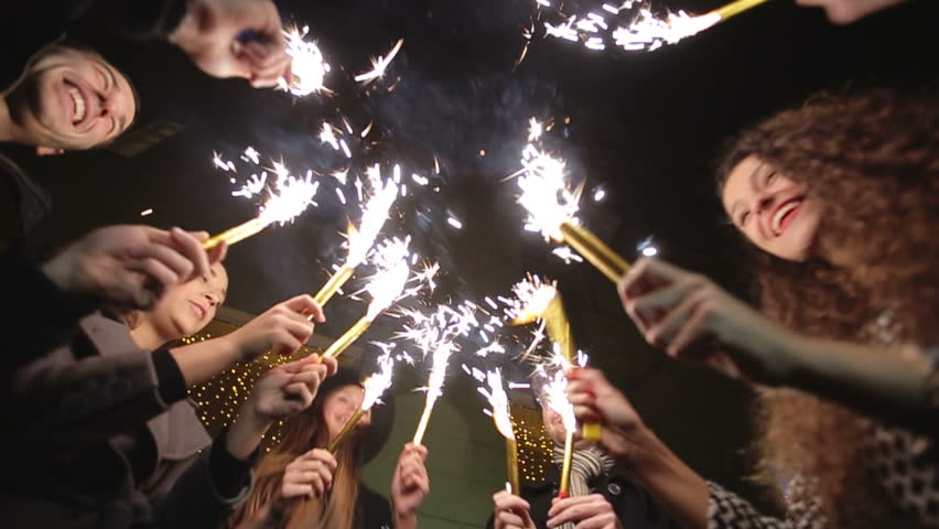 SLOW MOTION: Friends with sparklers dancing - HD stock footage clip
