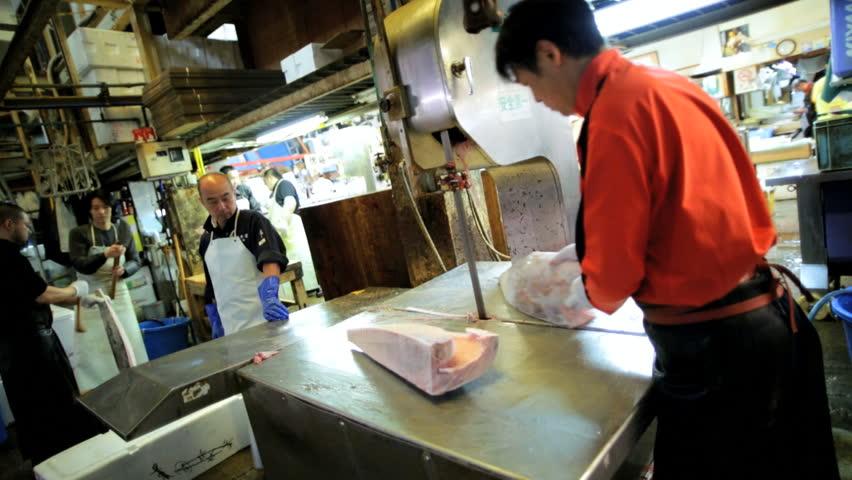 Tokyo - May 2014: Fishing industry Tuna Japanese workers seafood Tsukiji Fish Market wholesale Retail Tokyo Asia Japan - HD stock video clip