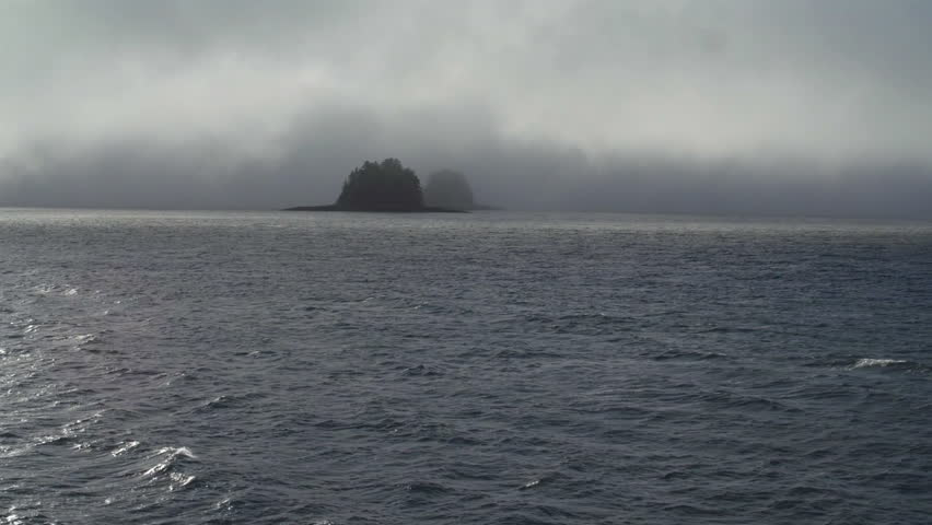 "Two ""gumdrop"" islands in Alaska's Inside Passage seen partially obscured by fog from the deck of a passing boat. #7881601"