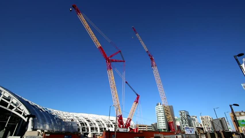 MANCHESTER, UK - NOVEMBER 5, 2014: Cranes above Victoria Station, Manchester which are helping the construction of the tram terminal for the second cross-city tramway.