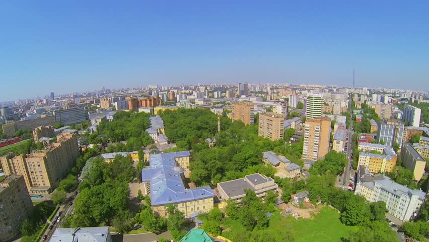 Cityscape with edifice of Central Academic Theatre of Russian Army at sunny spring day. Aerial view - HD stock footage clip