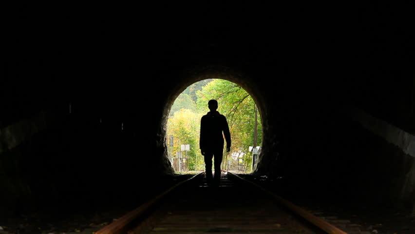 Man Walking To Light End Of Tunnel, Search Of Hope Stock
