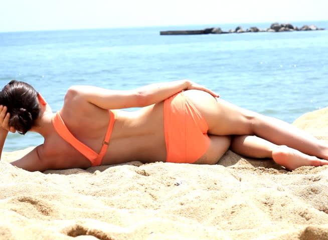 Woman lying on beach - NTSC - SD stock video clip