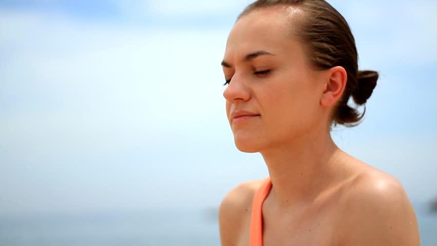 Woman in bikini drinking water - 1080p - HD stock video clip