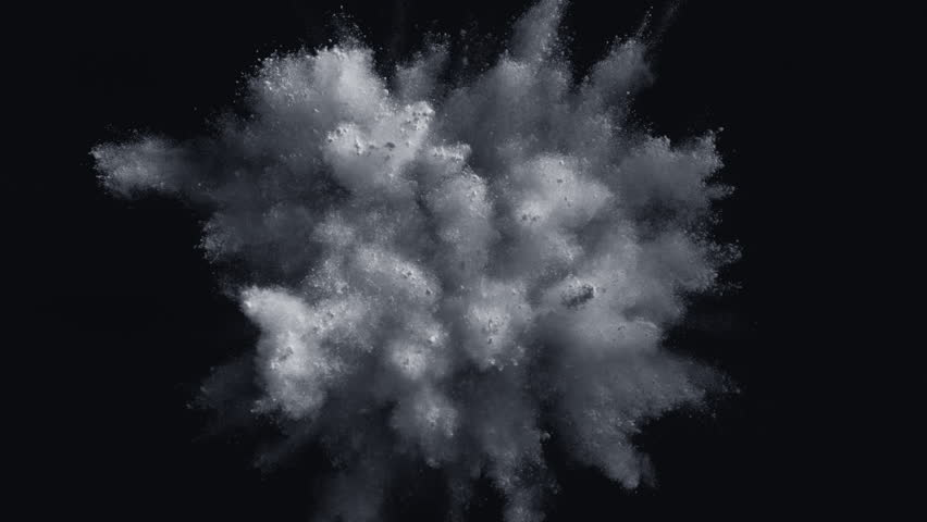 White powder/particles fly after being exploded against black background. Shot with high speed camera, phantom flex 4K. 4K 30fps. Slow Motion.