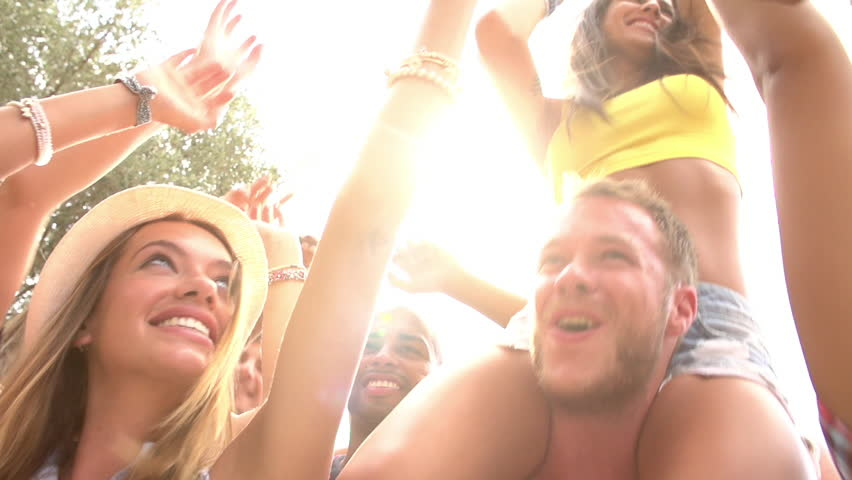 Slow motion sequence of dancers at party shot against the sun. Shot on Sony FS700 at a frame rate of 100fps