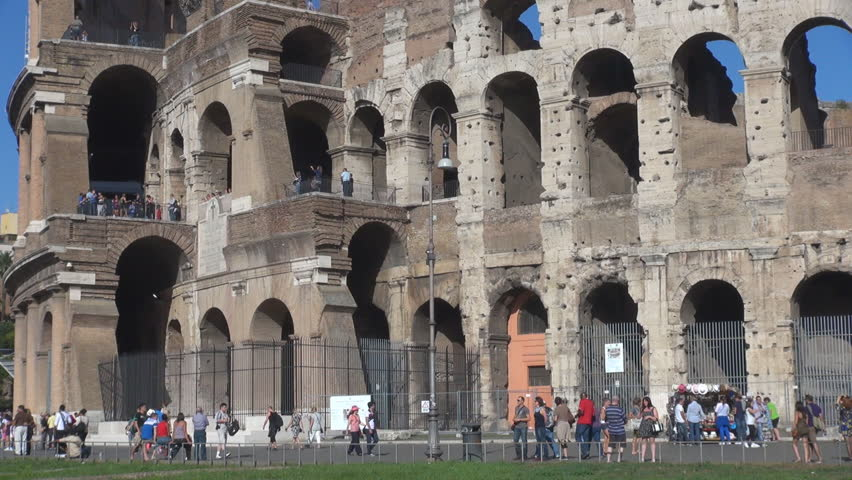 ROME - ITALY, SEPTEMBER 25, 2013, Tourist people visit Great Colosseum forum in sunny day  - HD stock footage clip