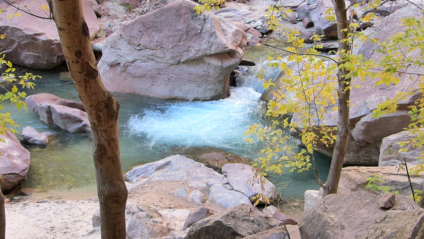A small waterfall flowing in Zion National Park, Utah, USA.  With natural sound and 1080p High Definition Video.