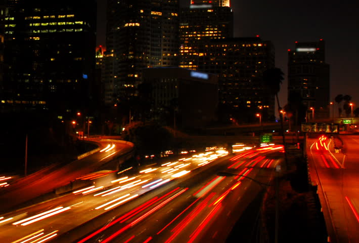 Highway through city at night time lapse