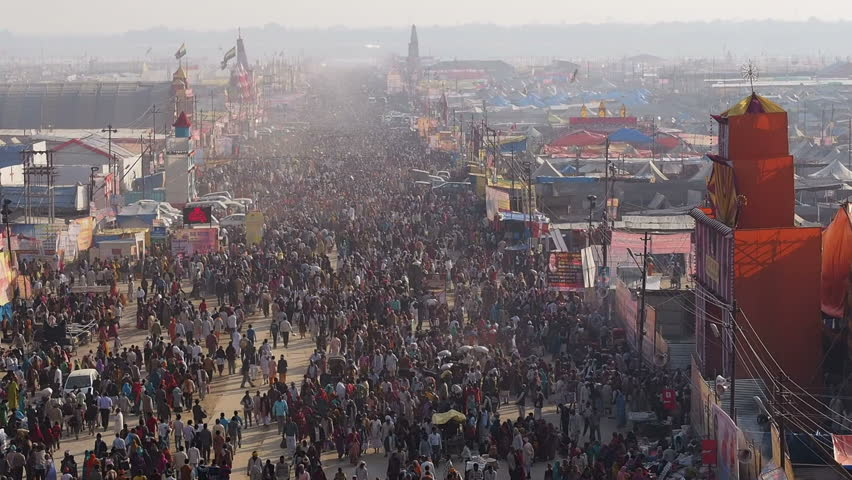 Allahabad, Uttar Pradesh, India - February 8, 2013: Thousands of pilgrims attending the Kumbh Mela festival, the world's largest religious gathering, in Allahabad, Uttar Pradesh, India.