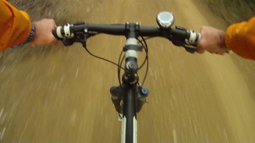 Mountain Bike traveling fast along dirt track