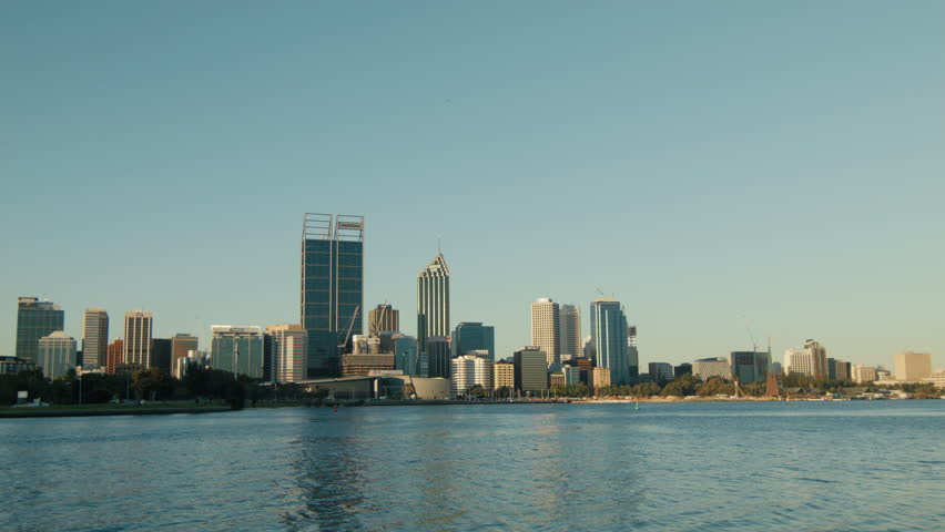 View of the Swan River and the Perth City skyline. - HD stock footage clip