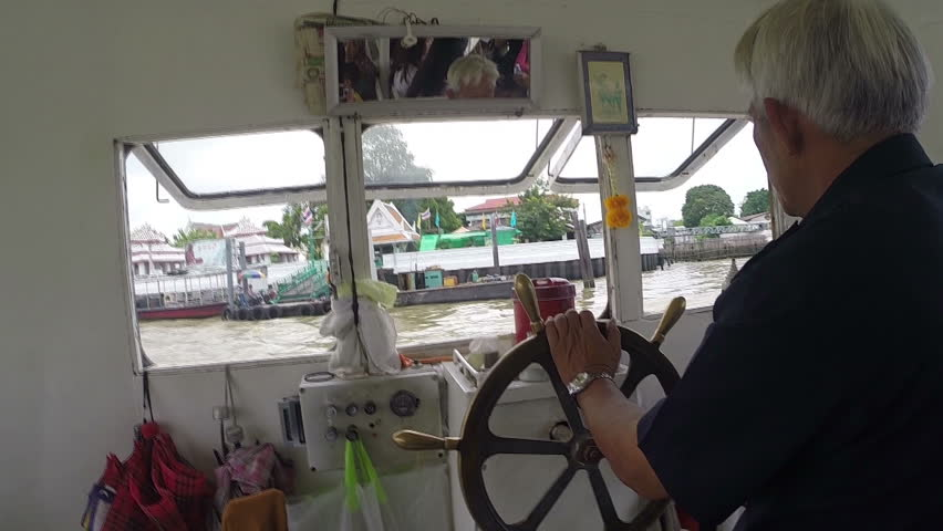 THAILAND - OCTOBER 12: Captain turns the steering wheel in Bangkok, Thailand October 12, 2014. Bangkok, Thailand.