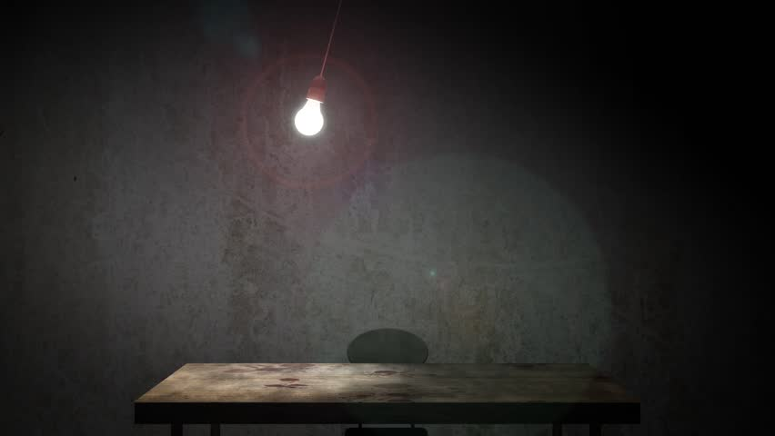 A classic old interrogation room with swinging incandescent bulb. The camera slowly zooms in to scene to enhance the eerie atmosphere.