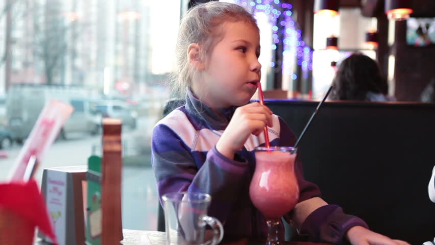 Child with mother tasting cocktail together when sitting in restaurant | Shutterstock HD Video #8107987