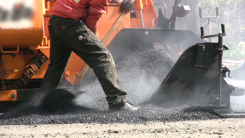 A road crew repairs the city street in Seattle, Washington. - HD stock video clip