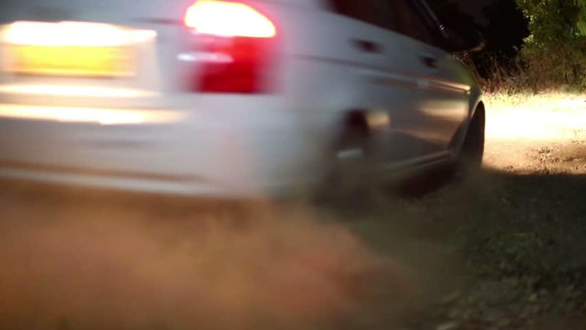 Car Drift's. Car drifting on the high speed and makes a sand cloud.