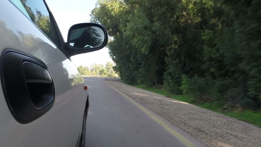 Car riding on beautiful road. View