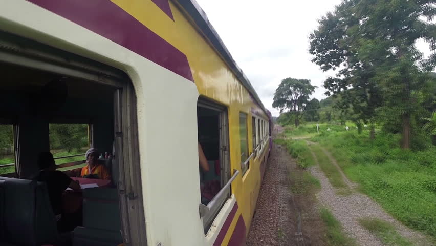 NORTH OF THAILAND, MAY 9, 2014: Passenger train goes to the north from Bangkok, through the forest, on MAY 9, 2014, in Thailand.