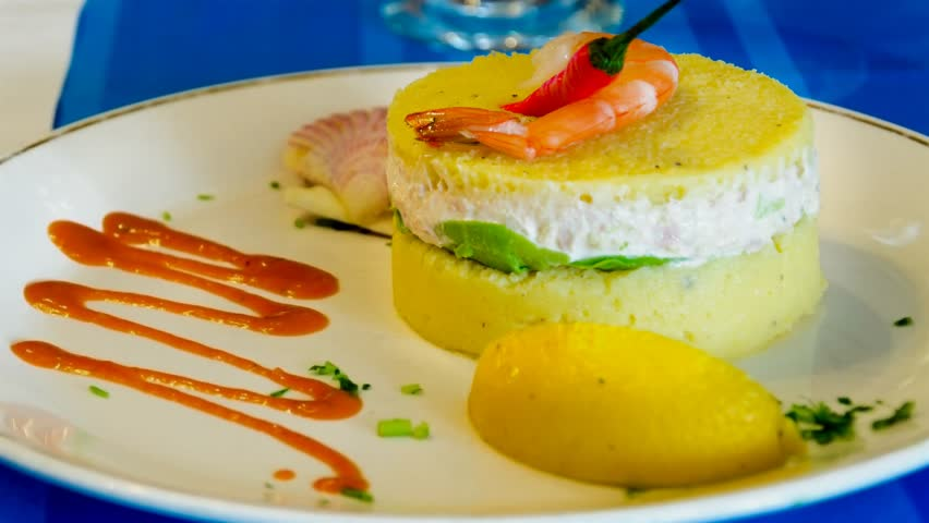 Causa a traditional Peruvian cuisine dish. Peruvian cuisine reflects local practices and ingredients from the indigenous population like the Inca and cuisines brought in with immigrants from Europe  - 4K stock video clip