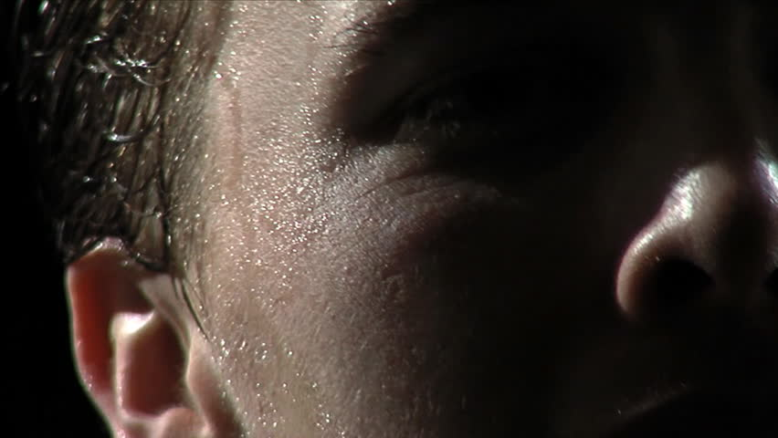 Back lit athlete. Straining face. Shot at 60fps. Closeup detail on face.