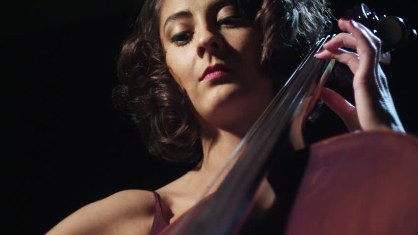 A young  cellist  plays her instrument.  - HD stock video clip