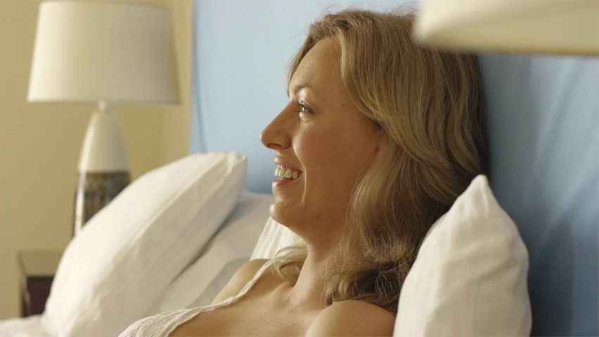 Playful Couple In Bed With Rose. - HD stock footage clip