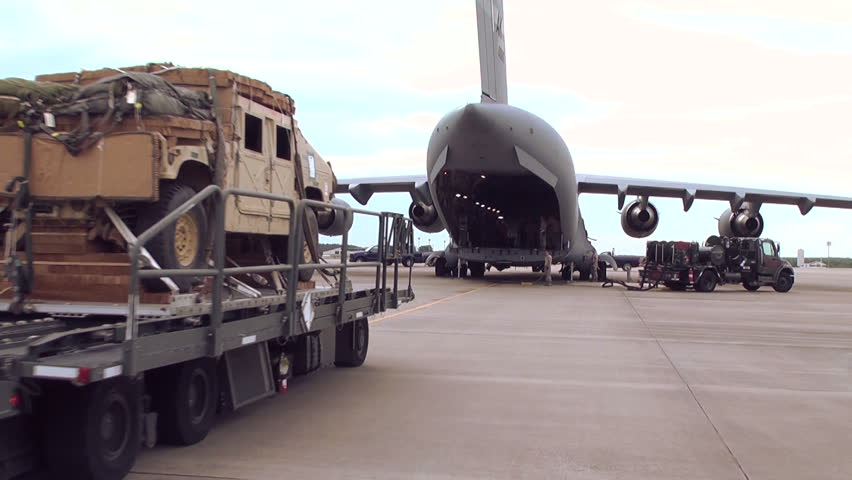 FORT BRAGGNORTH CAROLINA, JUNE 2013, A C 17 is loading with cargo. A car is loaded. - HD stock video clip