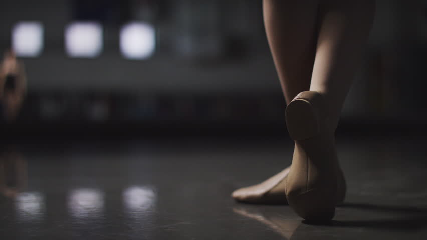 Ballet, Ballerina Dancer spins elegantly in a dance studio in slow motion