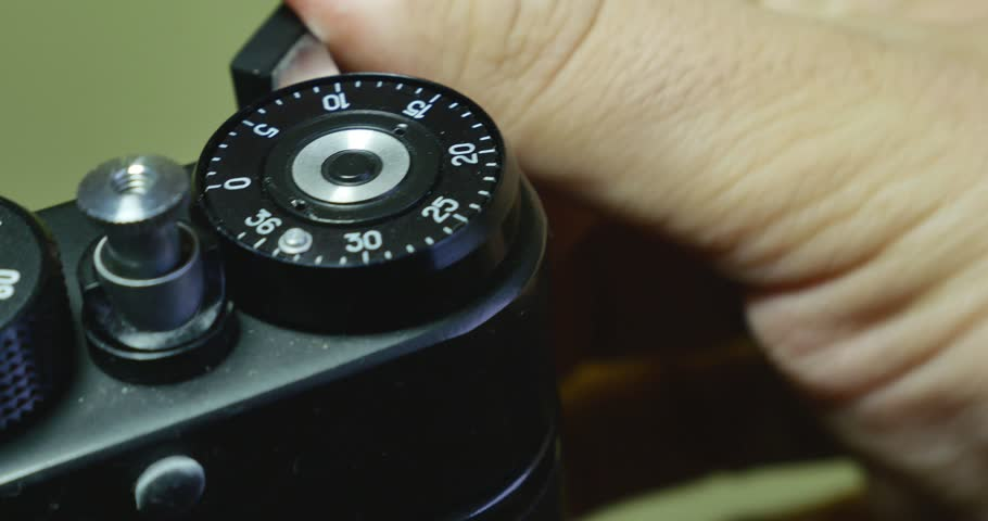 4K footage of pressing the shutter button on an old camera - with sound/Pressing the shutter button