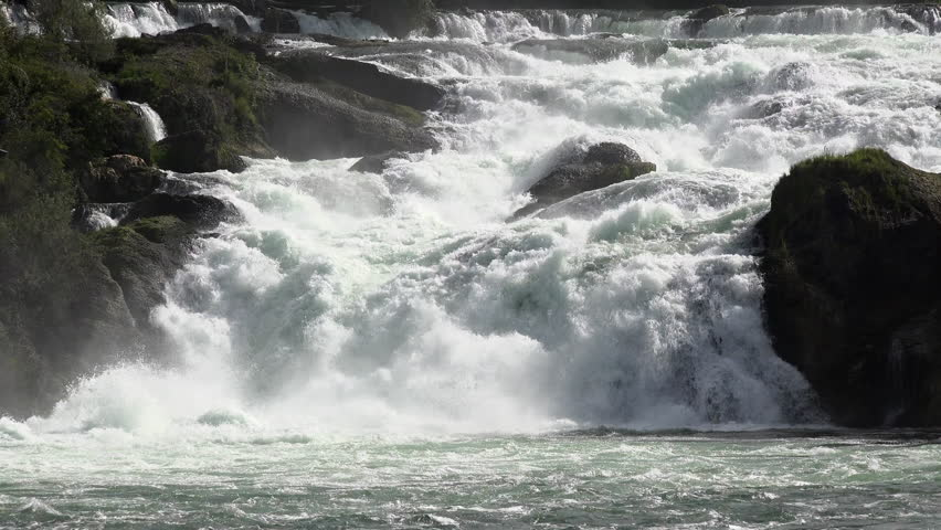 Switzerland Rhine Falls natural waterfall river. Rhine Falls in Switzerland, Rheinfall in German, largest natural river waterfall in Europe. Tourist destination and ecological environmental landscape. - 4K stock footage clip