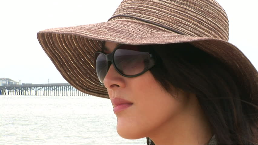 Portrait of woman at beach with sun hat - HD stock footage clip