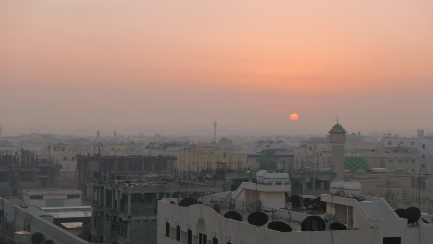 Middle East city view (Timelapse), Sun Rising through clouds, Haze passing Mosque (City of Dammam, Saudi Arabia)