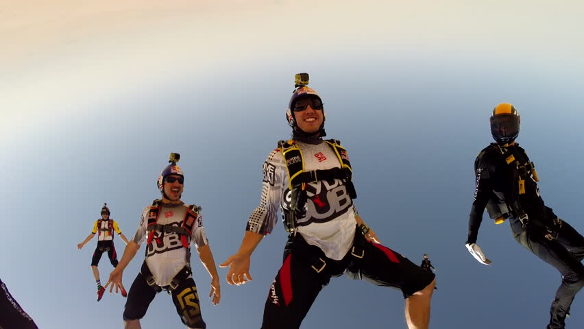 A group of skydivers skydiving in the sky, POV - HD stock video clip