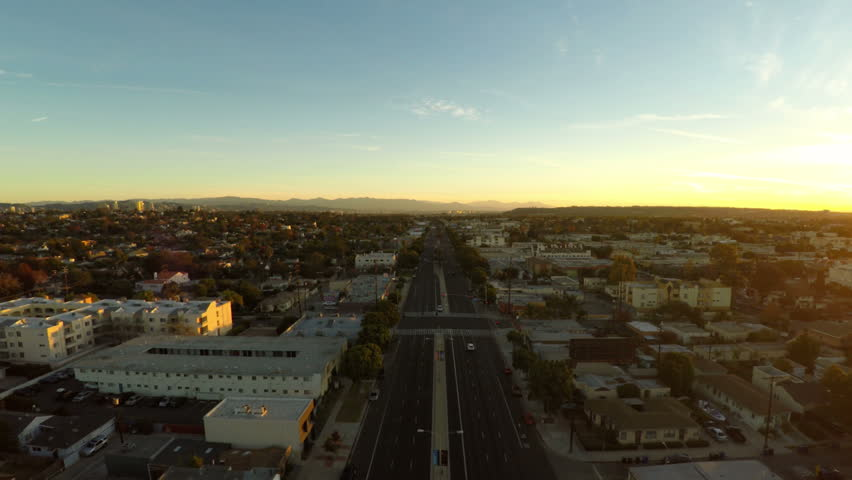Los Angeles Aerial 7 Low flying LA aerial over Venice Blvd at sunrise.   Shutterstock HD Video #8256424