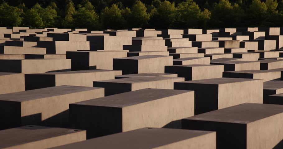 BERLIN, GERMANY - JUNE 30, 2014 Establishing Shot Homage Mass Murder Second World War Daytime German Flag Granite Stone Memory of Jew ( Ultra High Definition, Ultra HD, UHD, 4K, 2160P, 4096x2160 )