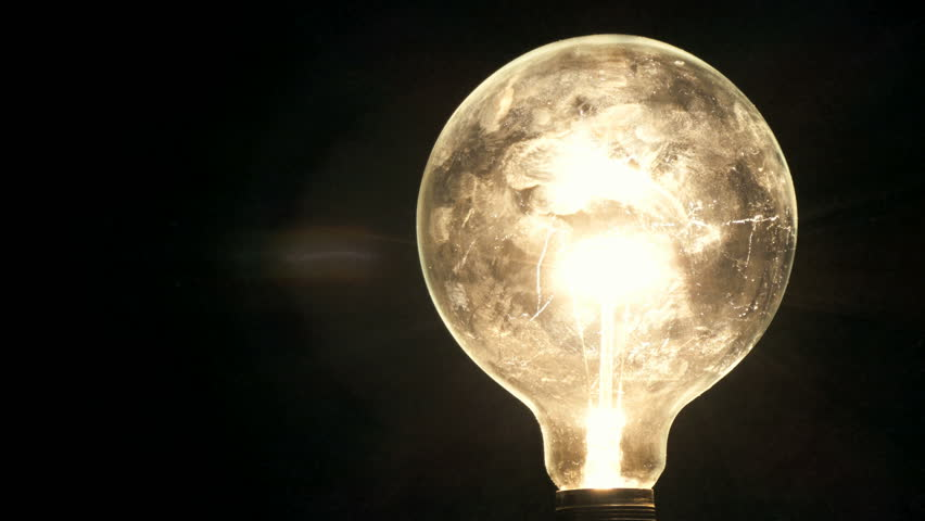 Light bulb turning on and off on black background, shot in 4K | Shutterstock HD Video #8319892