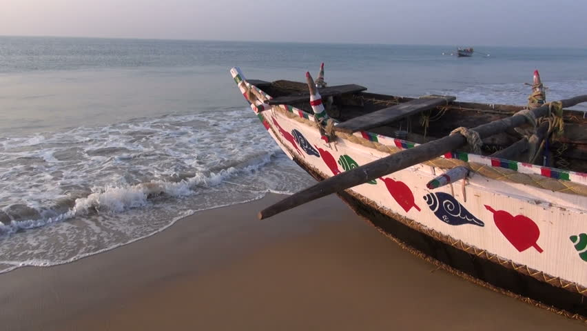 beautiful ornamental wooden fishing boat on Arabian sea beach in Odisha, India - HD stock video clip