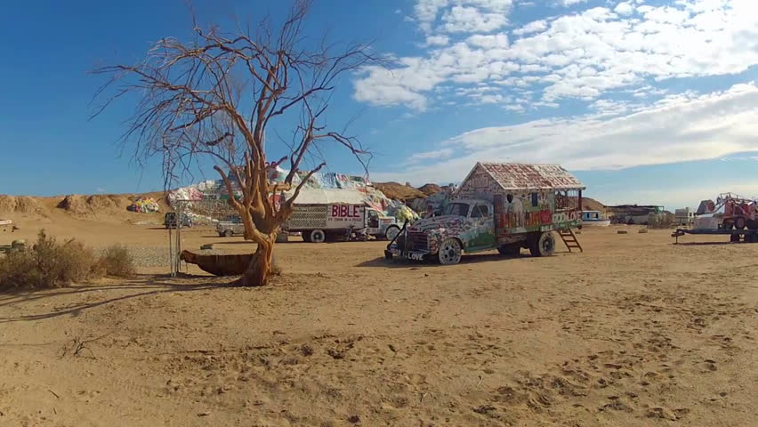 NILAND, CA: December 6, 2014- Shot of colorful vehicles with Bible messages painted on them circa 2014 in Niland. Old trucks are adorned with biblical verses at site of Salvation Mountain.