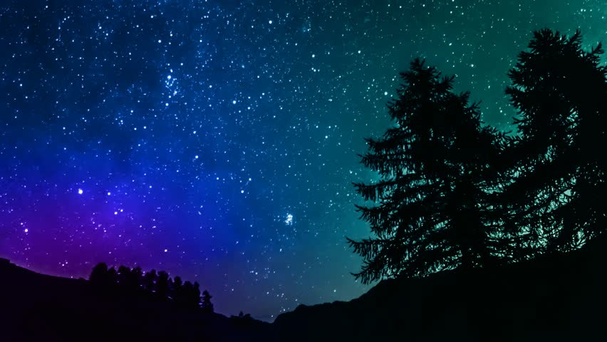 Timelapse Of Stars Moving In Night Sky Over Mountain Stock