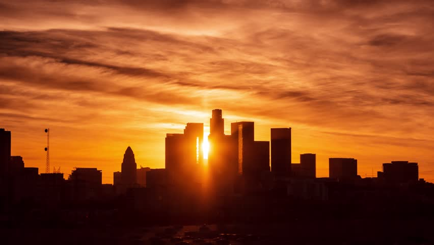 Beautiful red sunset to night transition over downtown Los Angeles skyline. 4K UHD Timelapse.