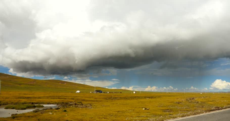 4k huge clouds mass rolling over namtso road,herdsman tent.,Danggula(Tanggula) Mountains in xizang Plateau,herdsman tent,roof of the World. gh2_09227_4k