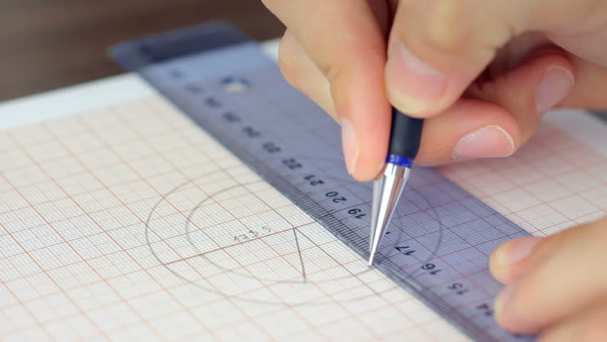 Drawing Lines Using A Ruler : Hand drawing a line with pencil using ruler on the graph
