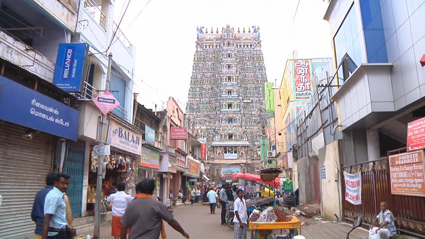 MADURAI - CIRCA 2014: Wide Shot of street with crowds of people at West Tower, Meenakshi Amman Temple circa 2014 in Madurai, Tamil Nadu, India. - HD stock video clip