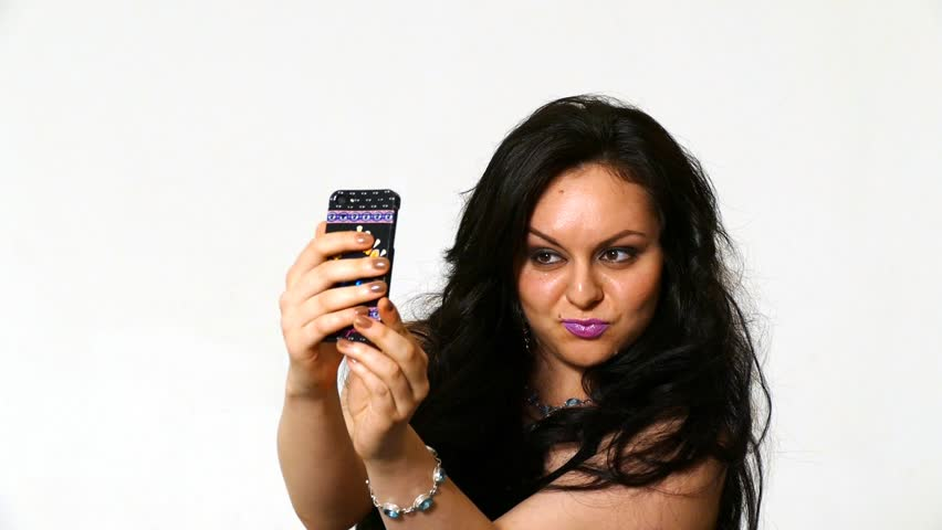 pretty girl make a duck face, and take a self portrait with her smart phone - HD stock footage clip
